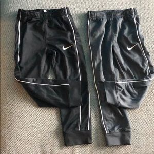Two Toddler Boy Nike joggers .  In good condition